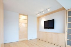 Custom entertainment center by NYC Millwork